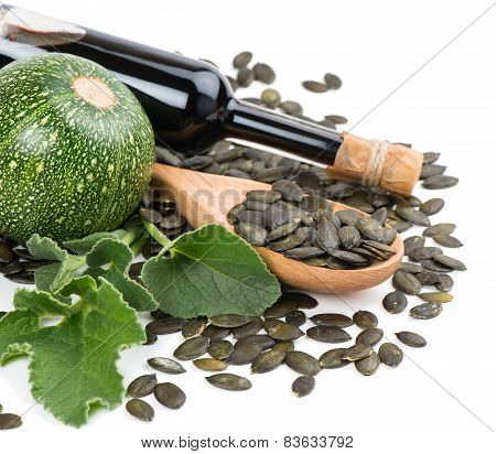 Glass Bottle Of Pumpkin Seed Oil, Pumkin And Peeled Pumpkin Seeds
