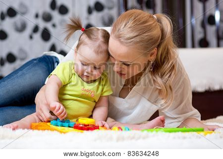 mother and kid boy play together indoor