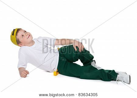 Dreaming Boy Is Lying On The White