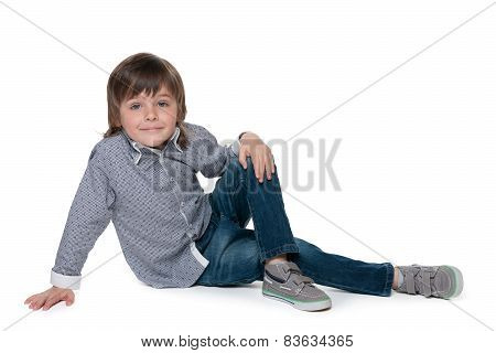Cute Little Boy Sits On The Floor