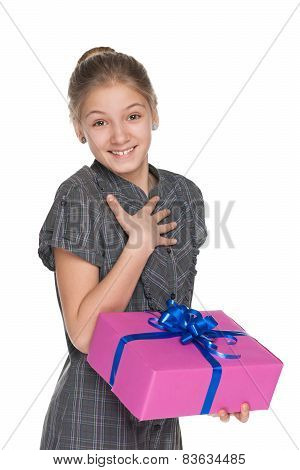 Pretty Girl Holds A Gift Box