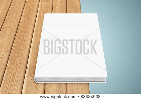 Texbook on the edge of table
