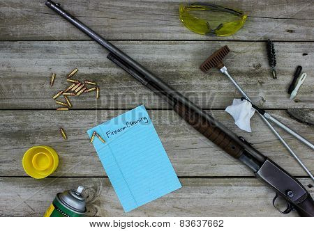 Rifle with cleaning tools on wood workbench