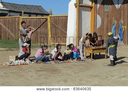 People sell souvenirs at the entrance to the Erdene Zuu monastery in Kharkhorin, Mongolia.