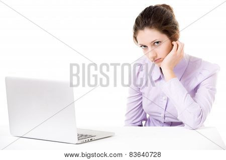 Young Woman Not In The Mood For Work In Front Of Laptop