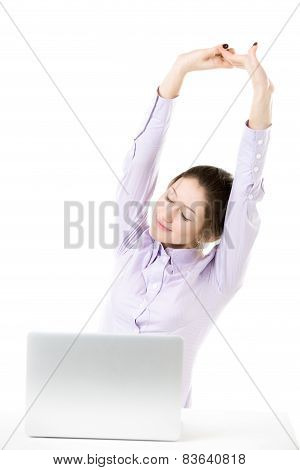 Tired Young Girl Stretching In Front Of Laptop