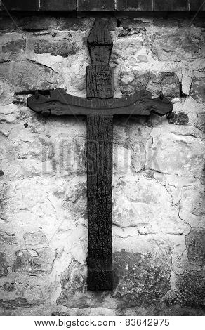 Old wooden Christian cross. Black and white photo