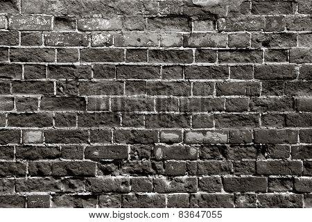 Old Brick Wall With Dark Bricks