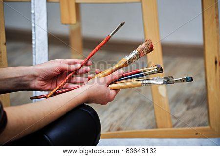 Painter holds the brush