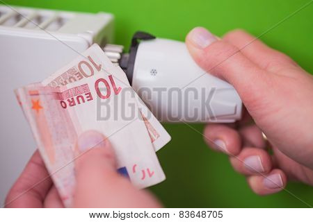 Radiator Thermostat, Banknote And Hand - Green
