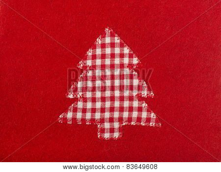 Christmas Tree Shape On Red Wool Background.