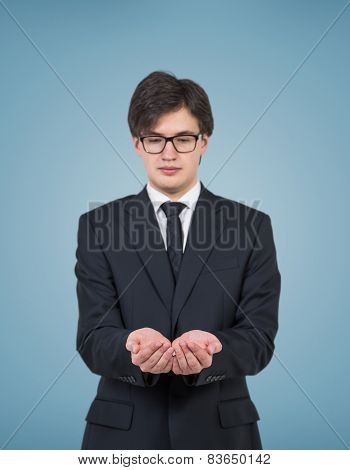 Businessman Holding Invisible Object
