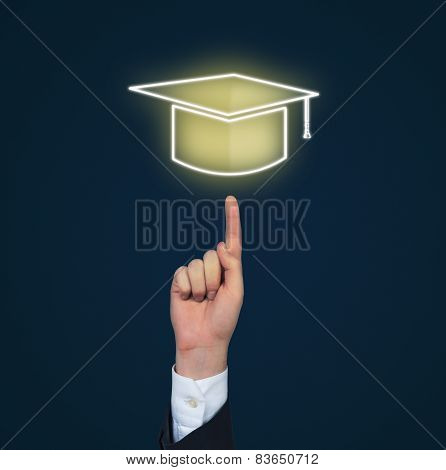 Hand Pointing To Bachelor Cap