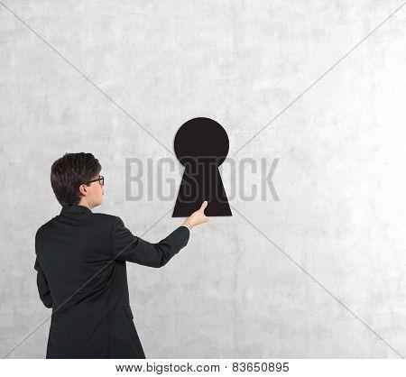 Businessman Holding Keyhole