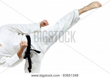 Mawashi geri kick is doing sportsman in a white karategi