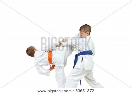 Sportsmen in karategi are doing paired exercises karate