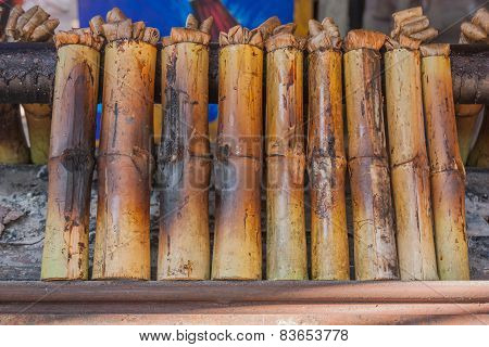 Glutinous Rice Roasted In Bamboo Joints, Thailand.