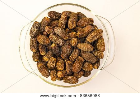 closeup view of Dry Medjool variety Dates fruit arranged in a glass bowl