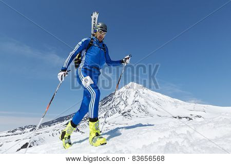 Ski Mountaineering Championships: Ski Mountaineer Climb To Mountain With Skis Strapped To Backpack