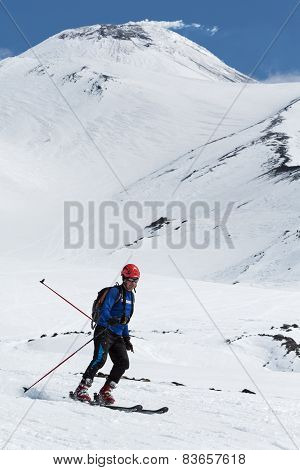 Ski mountaineering: ski mountaineer rides skiing from volcano
