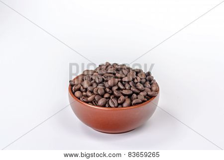 bowl full of coffee beans isolated on white backgrond