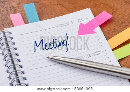 A daily planner with the entry Meeting