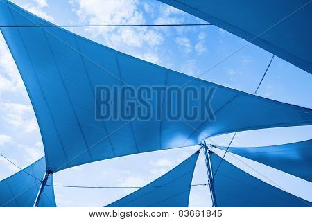 Awnings In Sails Shape Over Cloudy Sky