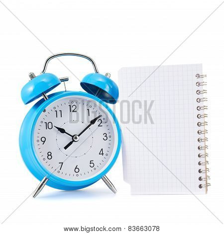 Alarm clock and notebook composition