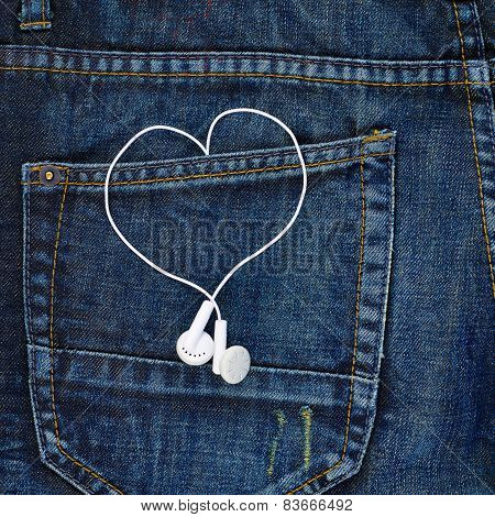 Headphones in a back pocket of a jeans