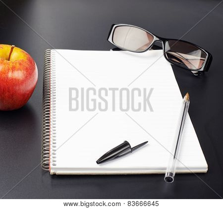 Apple, glasses and note book