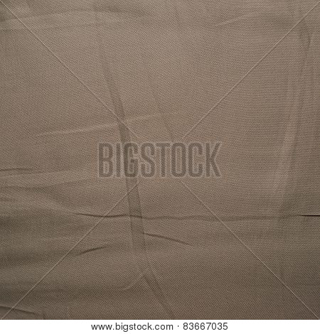 Brown silk cloth material fragment