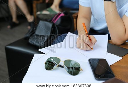 Business Woman's Hand With Pen Completing Information Form