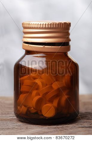 Pills In A Opened Glass Vial