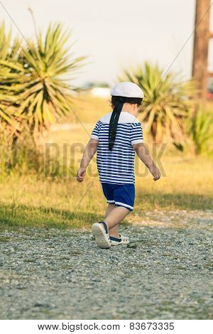 Toddler Dressed As A Sailor Walking With Determination