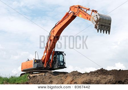 Loader Excavator At Construction Works