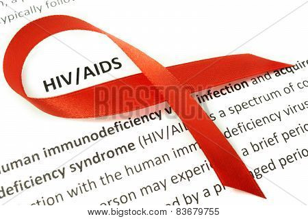 Paper with Hiv aids and red ribbon