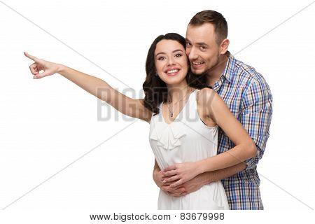Smiling lovers looking at camera
