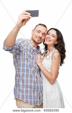 Lovers smiling and making selfie