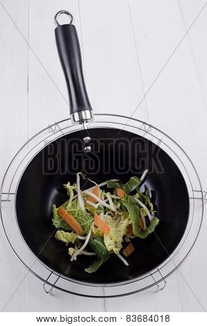 Raw Stir Fry In A Black Wok