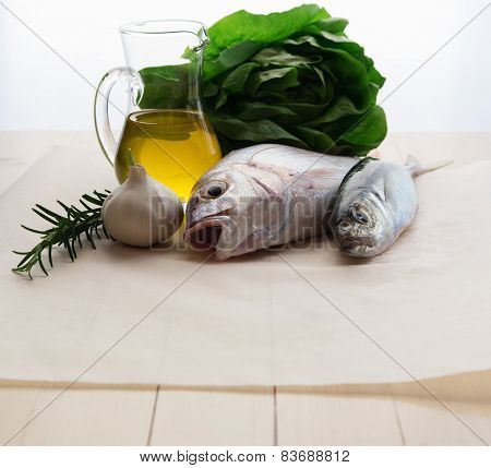Fresh fish with garlic, rosemary and olive oil