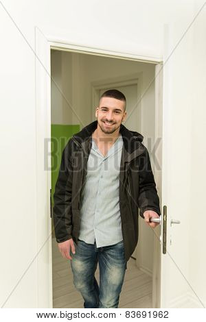 Young Man Entering Through His Front Door