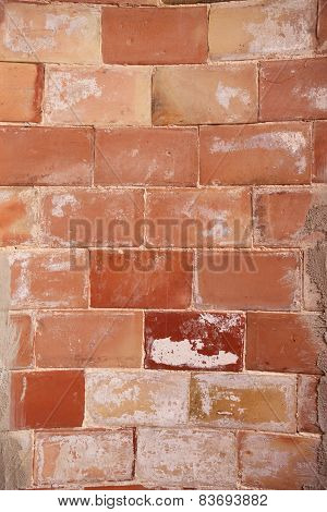 Detail of a semicircular rough brick wall