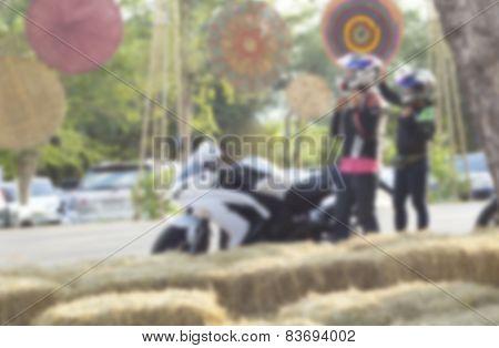 Blurred Men And Women Wearing Helmet With Motorcycle