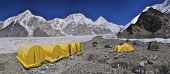 image of shan  - Scenic panorama of tents on Engilchek glacier in picturesque Tian Shan mountain range in Kyrgyzstan - JPG