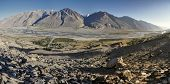 stock photo of arid  - Scenic panorama of valley on arid landscape in Tajikistan on sunny day  - JPG