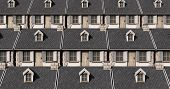 stock photo of quaint  - A tiled pattern made up of tightly packed quaint stone cottages - JPG