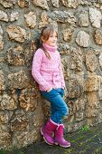 image of pullovers  - Outdoor portrait of adorable little girl wearing pink pullover - JPG