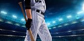 stock photo of arena  - Professional baseball players on the grand arena in night - JPG
