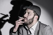 foto of mafia  - Mafia man smoking light do strong shadow - JPG