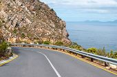 stock photo of fynbos  - Road to viewpoint at Steenbras Dam pump station in Gordons Bay near Cape Town South Africa - JPG